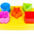 Shape sorter toy with various coloured blocks isolated — Stock Photo #45185637