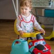 Beautiful cute little boy riding sport toy car — Stock Photo #49139217