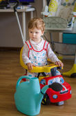 Beautiful cute little boy riding sport toy car — Foto de Stock