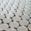 Endless rows of metallic silver tins — Stock Photo