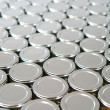Foto Stock: Endless rows of metallic silver tins