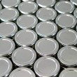 Endless rows of metallic silver tins — Stok fotoğraf