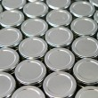 Endless rows of metallic silver tins — Foto de Stock