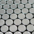 Endless rows of metallic silver tins — Stockfoto #22089727