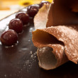 Glazed Chocolate cake and Cherries in a French Patisserie and Chocolaterie - Stock Photo