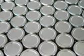Endless rows of metallic silver tins — Stock Photo