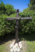 Crown of thorns on a wooden cross. — Foto de Stock
