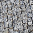 Grey cobblestone road - Stock Photo
