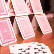 House of cards on a wooden table - Stock Photo