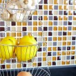 Wire vegetable rack in a kitchen — Stok fotoğraf