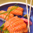 Fresh strips of Norwegian salmon Sashimi and rice Nigiri - Stock Photo
