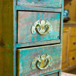 Stock Photo: Miniature turquois chest of Drawers