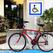 A bicycle in front of a sign. — Stock Photo #22095519