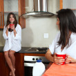 Sexy young adult brunette roommates — Stock Photo #22095553