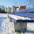 Bench covered in snow in a park in Munch. — Stock Photo