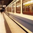 Moving train in a underground train station - Foto Stock