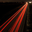 Light trails on highway — Stock Photo #22096849