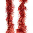 Red Christmas tinsel decoration — Stock Photo #22097885