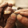 Goldsmith working on an unfinished 22 carat gold Wedding ring — Stock Photo #22097965