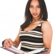 African-Indian businesswoman in casual office outfit with a daybook — Stock Photo