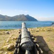Antique canons standing in their original defense posts of Houtbay in Western Cape, South Africa - Stock Photo