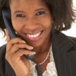 Portrait of a beautiful young African businesswoman talking on the phone - Stock Photo