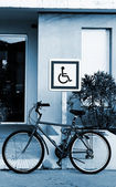 A bicycle in front of a sign — Stock Photo