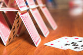 House of cards on a wooden table — Stock Photo