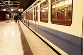 Moving train in a underground train station — Stock Photo