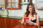 Sexy young adult brunette woman drinking coffee — Foto de Stock