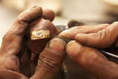 Goldsmith working on an unfinished 22 carat gold Wedding ring — Stock Photo