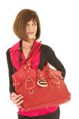 Sexy young adult Caucasian businesswoman with a red leather bag — Stock Photo