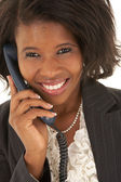 Portrait of a beautiful young African businesswoman talking on the phone — Stok fotoğraf