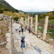 Tourists in the old ruins of the city of Ephesus in modern day Turkey — Stock Photo