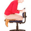 Blonde businesswoman playing on an office chair — Stock Photo #22100943