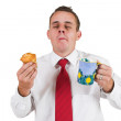 Businessmeating muffin and holding cup — Stock Photo #22101827