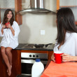 Sexy young adult brunette roommates — Stock Photo #22103647