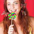 Young female adult fashion model with a big multi-colored lollipop — Stock Photo