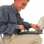 Man sitting on ladder working on laptop — Stock Photo