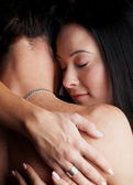 Young adult Caucasian couple in passionate embrace — Stock Photo