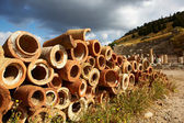 Old clay pipes for plumbing in the old ruins of the city of Ephesus in modern day Turkey — ストック写真