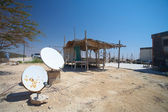 Rural communication through satellite dishes — Stock Photo