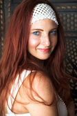 Young female adult fashion model with natural red hair — Stock Photo