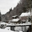 Small Snowcovered firewood barn in the German Alps - Foto Stock