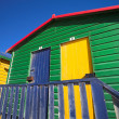 Multi-colored dressing rooms on the beach - Stock Photo
