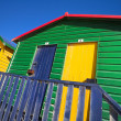 Multi-colored dressing rooms on the beach — Stock Photo
