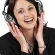 Woman in formal black suit with headset on head — Stock Photo