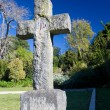 Old stone Grave in the shape of a cross - Stock Photo
