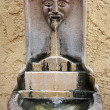 Old ornate public drinking fountain in Cannes, France - Stock Photo