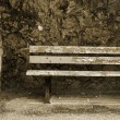 Old bench in the Original Harbour blocking wall — Stock Photo